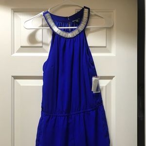 Blue romper with a beaded neckline!